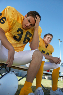 Two football players sitting on bench  low angle viewの写真素材 [FYI03627399]
