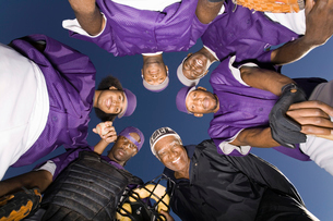Baseball team in huddle  (portrait)  (view from below)の写真素材 [FYI03627743]