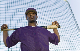 Baseball player holding bat during practice  (portrait)の写真素材 [FYI03627747]