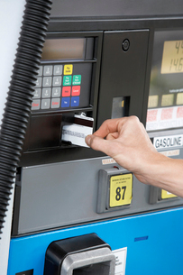 Person paying with credit card at gas pump  close up of haの写真素材 [FYI03627942]