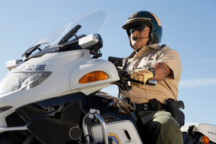 Police officer riding on motorcycleの写真素材 [FYI03628045]