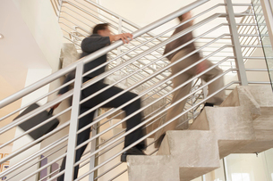 Businessmen climbing stairwell  low angle viewの写真素材 [FYI03628512]