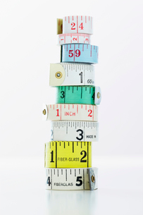 Stack of rolls of measuring tape  close-upの写真素材 [FYI03629292]