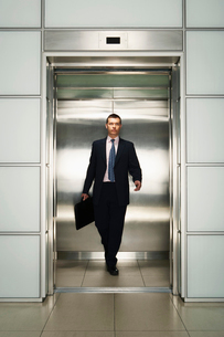 Businessman Exiting Elevator  front viewの写真素材 [FYI03629299]