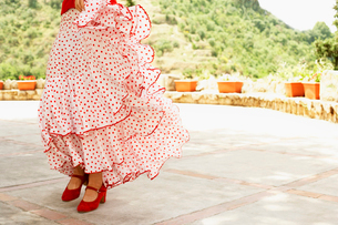 Woman flamenco dancing outdoors  close-up.の写真素材 [FYI03629531]