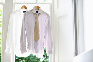 Two Dress Shirts on Hangers in domestic windowの写真素材 [FYI03629901]