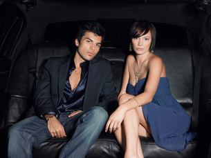 Couple in evening wear in back of limousineの写真素材 [FYI03630575]