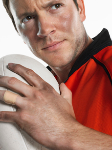 Rugby player holding ball  close-up  portraitの写真素材 [FYI03630677]
