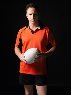 Rugby player standing holding ball  portraitの写真素材 [FYI03630679]