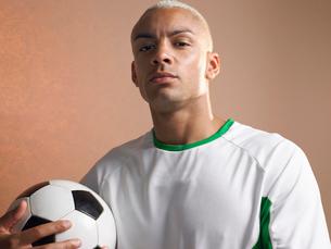 Football player holding ball  portraitの写真素材 [FYI03630680]