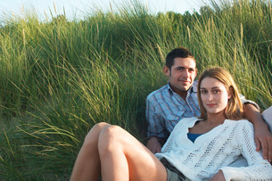 Couple Relaxing in Tall Grass  portraitの写真素材 [FYI03630821]
