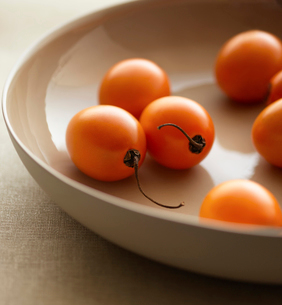 Cherry Tomatoes in Bowl  close-upの写真素材 [FYI03631216]