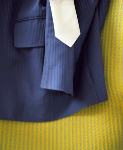 Suit and Tie on Bed with yellow cover  close-upの写真素材 [FYI03631438]