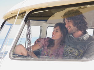 Couple Sitting in camper van  view through windscreenの写真素材 [FYI03631783]
