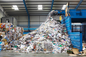 Waste coming out of machine in recycling factoryの写真素材 [FYI03632239]