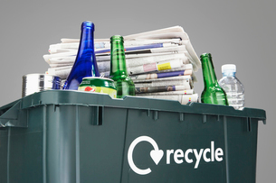Recycling bin filled with waste paper and bottles  close-uの写真素材 [FYI03632407]