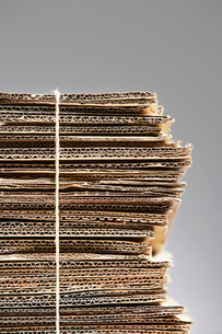 Bundle of waste cardboard tied with string  close-upの写真素材 [FYI03632414]