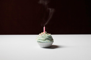 cupcake with blowed birthday candleの写真素材 [FYI03633636]