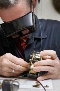 Clock Repairman at Workの写真素材 [FYI03633828]