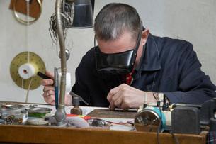 Clock Repairman at Workの写真素材 [FYI03633834]