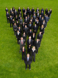Group of business people standing in triangle formationの写真素材 [FYI03634377]