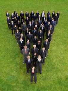Group of business people standing in triangle formationの写真素材 [FYI03634378]
