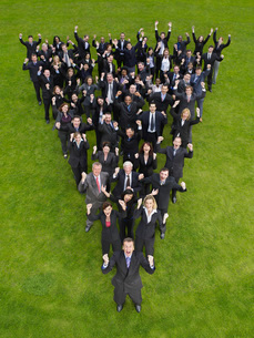 Large group of business people standing in triangle formの写真素材 [FYI03634379]