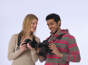 Young photographers with cameras studio shotの写真素材 [FYI03634723]
