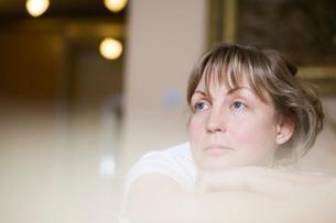 Pensive mature woman,close-up view,selective focusの写真素材 [FYI03634892]