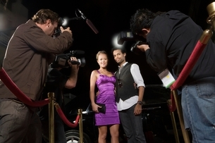 Celebrity couple being photographed at media eventの写真素材 [FYI03635059]