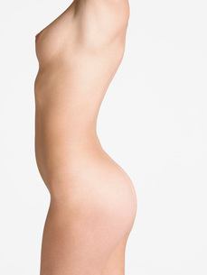 Nude Young Woman  side view  mid sectionの写真素材 [FYI03635182]