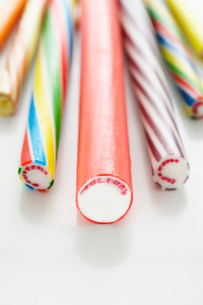 Close up of rock candy sticks  elevated view  studio shotの写真素材 [FYI03635373]