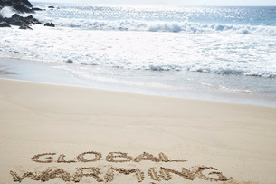 Global warming text written in beach  elevated viewの写真素材 [FYI03635759]