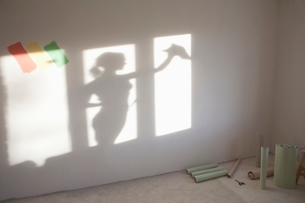 Shadow of woman cleaning windows in new apartmentの写真素材 [FYI03635927]