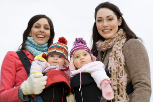 Two mothers with babies in baby carriersの写真素材 [FYI03636374]