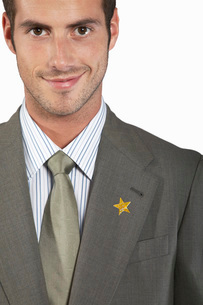 Businessman with gold star on suit  portraitの写真素材 [FYI03636413]