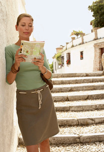 Tourist standing on steps reading map in Granada  Spain  fの写真素材 [FYI03636549]