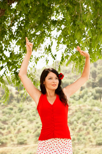 Woman flamenco dancing outdoors  front view.の写真素材 [FYI03636584]