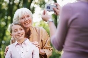 Grandmother With Granddaughter Posing For Photographの写真素材 [FYI03636649]
