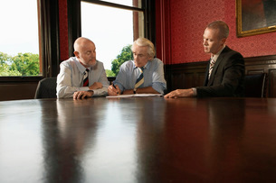 Two Older Men and One Younger Man in Meetingの写真素材 [FYI03636926]