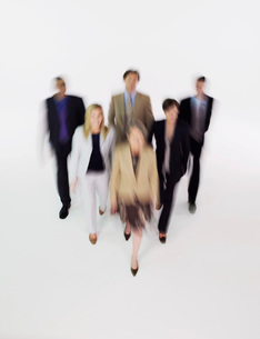 Group of businesspeople walking  blurred effectの写真素材 [FYI03637009]