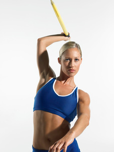 Female athlete preparing to throw javelin  front viewの写真素材 [FYI03637139]