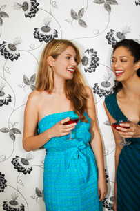 Two women Drinking Martinis by floral print wallの写真素材 [FYI03637162]
