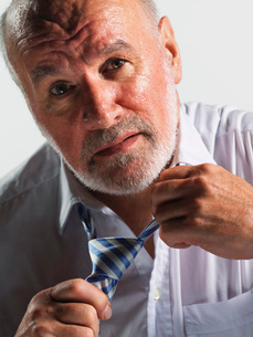 Hot businessman loosening tie  close-upの写真素材 [FYI03637272]