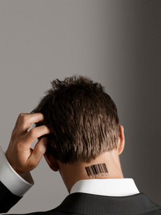 Young man with bar code tattoo on his neck  scratching heaの写真素材 [FYI03637427]
