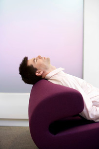 Casually dressed Businessman Sleeping on modern sofa  profの写真素材 [FYI03637468]