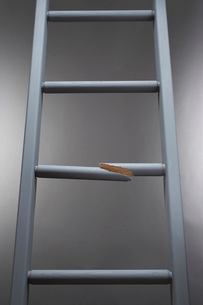 Ladder with one step brokenの写真素材 [FYI03637641]