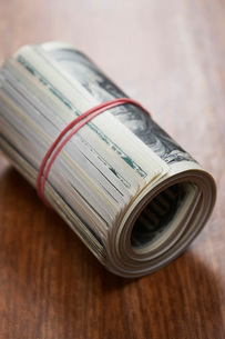 Roll of dollar bills  close-upの写真素材 [FYI03637646]