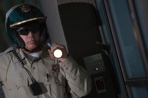 Nightwatch patrolman with flashlightの写真素材 [FYI03637961]