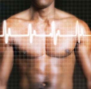 Man with electrocardiogram graph superimposed on chest mid sの写真素材 [FYI03638412]